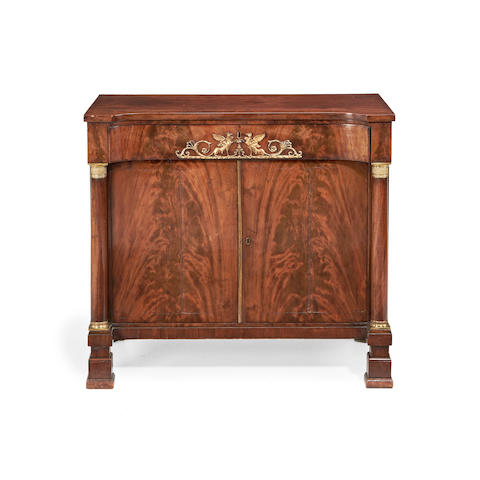 An Empire gilt metal mounted mahogany side cabinet