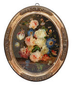 Three oval chrystolians depicting flowers In gilt oval frames