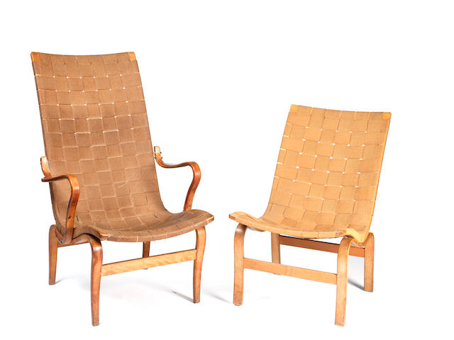 Bruno Mathsson (Swedish, 1907 - 1988):  Eva open armchair, plywood birch frame with woven canvas seat, 104cm, high labelled to frame, and another Eva chair model MI 471. (2)