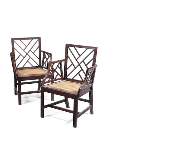 A pair of George III mahogany cockpen open armchairs