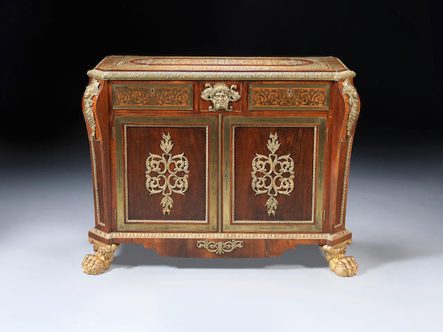 A George IV rosewood crossbanded, brass marquetry and parcel gilt side cabinet in the manner of Louis le Gaigneur, in the Louis XIV style