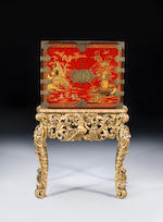 A William and Mary small scarlet japanned cabinet on a carved giltwood stand