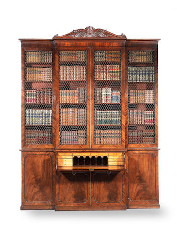 A Regency carved mahogany secretaire library bookcase