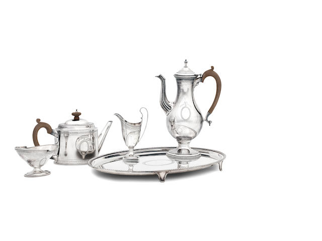 A four piece silver tea and coffee service with similar tray the tea service by C.J.Vanderberg Ltd, London 1988, 1990, 1991, the tray by the same maker, Sheffield 2000   (5) A four piece silver tea and coffee service with similar tray the tea service by C.J.Vanderberg Ltd, London 1988, 1990, 1991, the tray by the same maker, Sheffield 2000   (5)