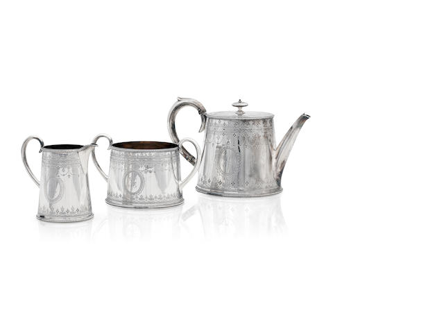 A Victorian silver three piece tea service  London 1874