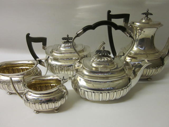 A five piece silver matching tea and coffee service By Walker and Hall, Sheffield 1913,1916,1917  (5)