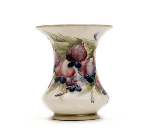A small William Moorcroft 'Wisteria' design vase Dated 1913