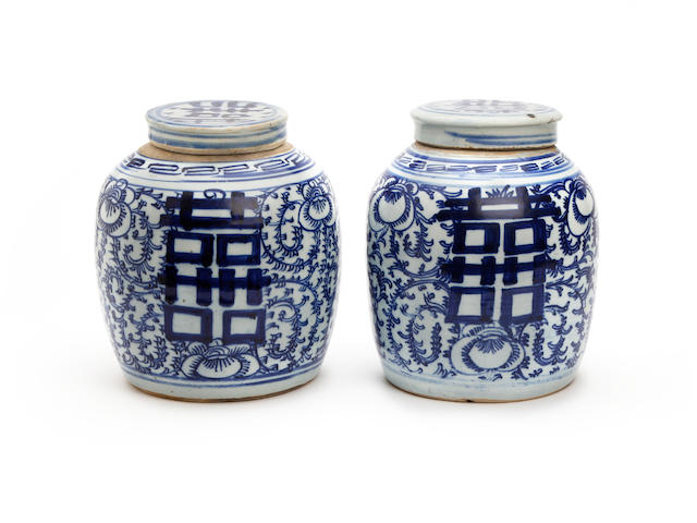 A pair of Chinese blue and white jars and covers Early 19th Century
