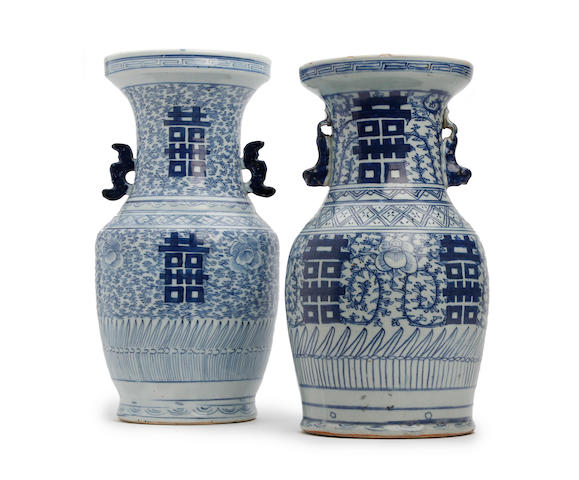 A pair of similar Chinese blue and white baluster vases Early 19th Century