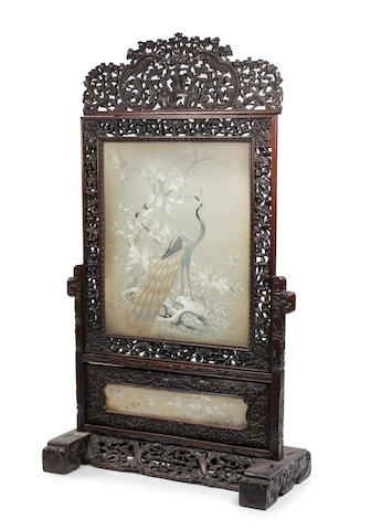A Chinese carved hardwood stand with embroidered panel Late 19th Century