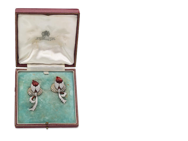 A pair of enamel and diamond brooches