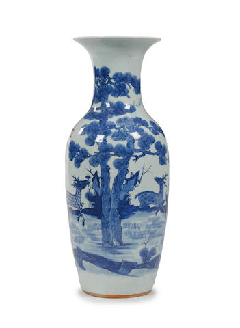 A Chinese blue and white baluster vase, on carved wooden stand, decorated with deer and prunus, possibly Kangxi