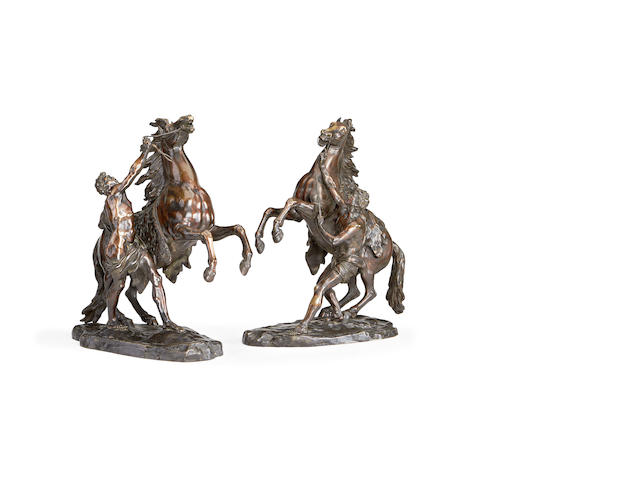 After Guillaume Coustou, French (1677-1746)  A large pair of late 19th century French bronze models of the Marley horses