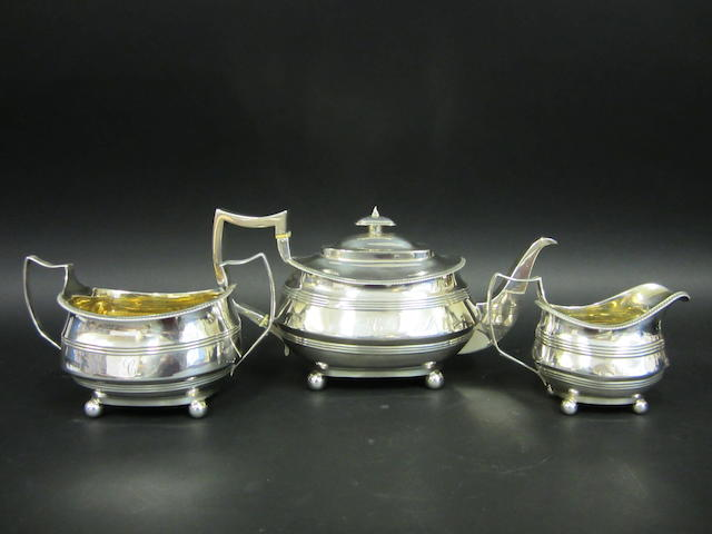 A George III silver three piece tea service by Wallis & Hayne, London 1817/18