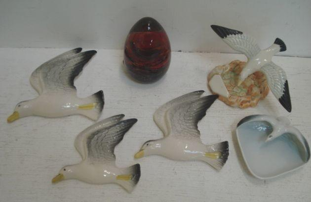 Three flying seagull wall plaques, impressed and painted marks, a similar ashtray with rockwork base, a German similar and a Mdina glass paperweight. (6)