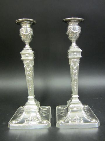 An Edwardian pair of silver candlesticks by William Hutton & Sons, London 1902