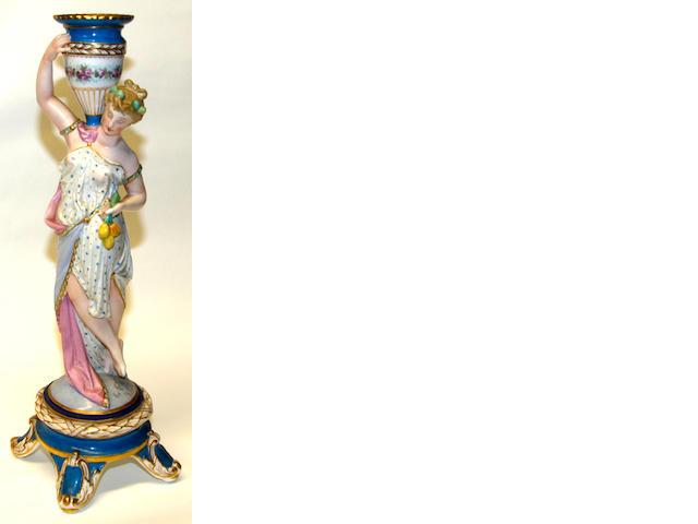 A Continental porcelain figural candlestick