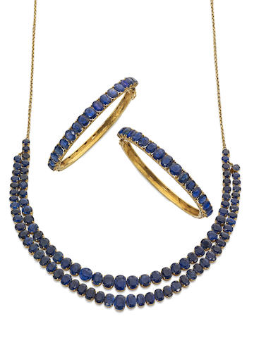A sapphire necklace and two sapphire bangles