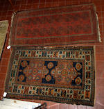 Six various Middle Eastern rugs, including:A Kurdish rug with hooked medallions on an indigo ground, 246 x 140cm; a Khotan rug with pale orange field and pistaccio border; a Belouch rug; an Ispahan rug; a Kurdish rug and an Afghan rug.(6)