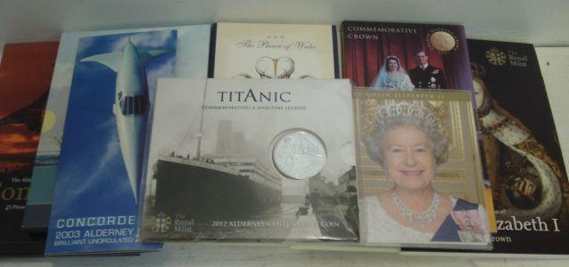 A collection of 33 Elizabeth II £5.00 coins, in Commemorative Presentation packs and another loose. (34)