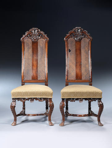 A pair of Anglo-Dutch carved walnut caned back side chairs probably late 17th century
