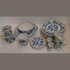 An extensive Meissen blue onion pattern breakfast and dinner service, and similar blue onion pattern tea and dinner ware by various factories.