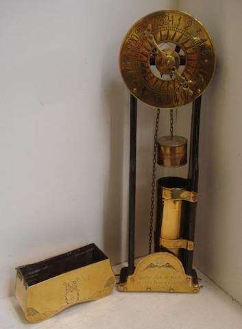 An old reproduction brass mounted wooden wall hanging water clock, inscribed 'Walter Ackrill fecit of ye olde towne Colchester Anno Don 1676', 65.5cm.
