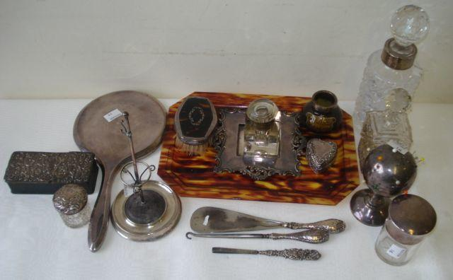 A silver hatpin stand moulded as a stick stand, Chester 1906, another globe form on pedestal foot, marks rubbed, silver topped trinket box, 1905, cut glass scent bottle with cage base 1903, a larger bottle with silver collar and salts bottle with screw cover, and four other silver mounted items, a cut glass inkwell on associated silver base, a silver mounted Kings ware match strike (a/f), a heart shaped silver pill box with embossed decoration, Birmingham 1900, a silver mounted tortoiseshell hair brush and faux tortoiseshell tray.