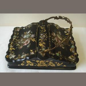 An early Victorian mother of pearl inlaid paper mache work box, central gilt metal handle with two hinged compartments, the paper lined interior with a receptacles for implements,26 x 18cm.