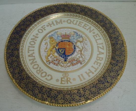 A large Paragaon circular dish, to Commemorate the Coronation of Her Majesty Queen Elizabeth II June 2nd 1953, painted in colours on a white and cream ground, cobalt blue border, heightened with gilding, 39cm.