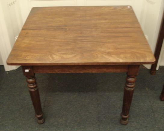 A late Regency mahogany extending dining table, in the manner of Gillows, lacking leaves, the well figured rectangular top with rounded corners, on ring turned lobed and fluted legs, 93 x 97.5cm.