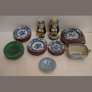 A Victorian Staffordshire doll's dinner service, printed and overpainted with flowers and leaves in iron red and blue, printed and impressed marks, early 19th Century English pearlware blue transfer printed dolls dinner ware, five small Victorian green leaf moulded plates and two Staffordshire Toby figure condiments.