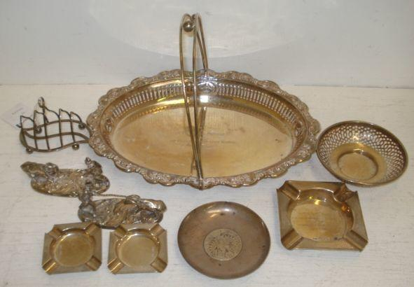 A George V oval silver cake basket, Birmingham 1912, with pierced sides, foliate embossed border and swing handle, inscribed, 29cm, and the following silver, three engine turned ashtrays, small wire work toast rack, bon bon dish, 20ozs, and a Marie Theresia thaler inset dish, also a pair of Victorian novelty electroplate figures of a gentleman with a reined mule, oval naturalistic bases, registration marks.