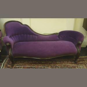 A Victorian rosewood frame chaise longue, of shaped outline, leafy scroll carved, button down upholstered in purple velvet, on cabriole legs, 200cm.