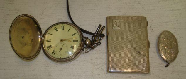 A George IV silver cased hunter pocket watch, hallmarked for 1829, the movement signed 'Simpson & Starkey, 29 Hatton Garden, London No. 9518', the white enamel dial with subsidiary seconds, and two keys, an engine turned silver cigarette case and oval locket stamped 'Sterling silver'.