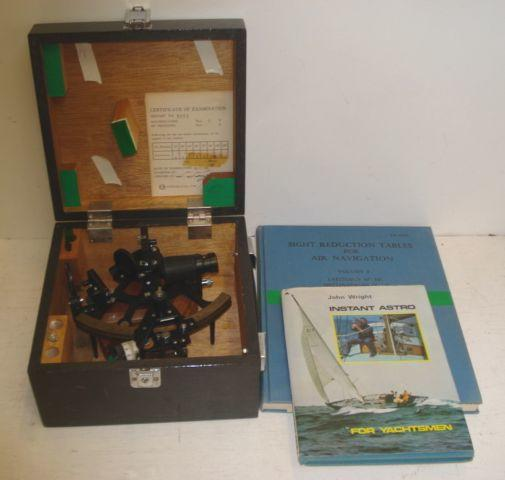 A black lacquered sextant, the brass arc signed 'Toizaki & Co Ltd Japan No. 8151', reading 15 degrees - 120 degrees, in wooden carrying case, sight reduction tables for Air Navigation, in two volumes and Instant Astro.(4)