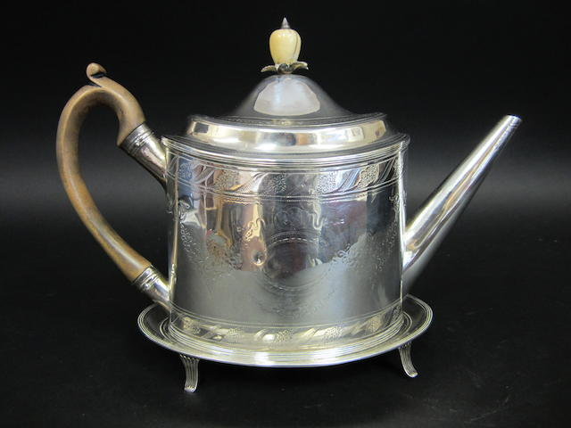 A George III silver oval bright-cut engraved teapot on stand by Peter & Anne Bateman, London 1795