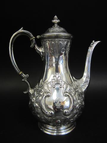 A Victorian silver baluster coffee pot by Martin & Hall, London 1884