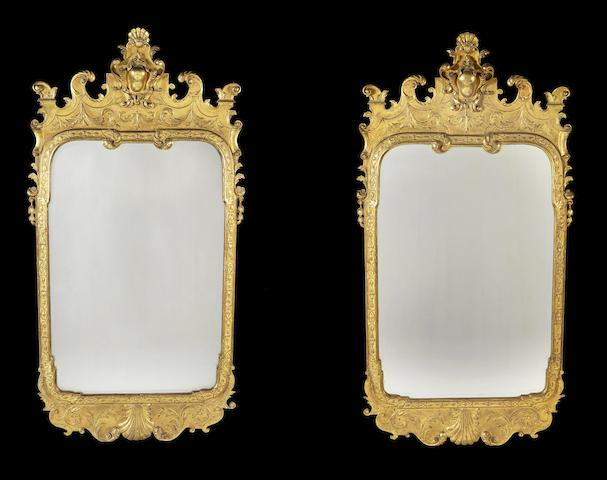 A pair of George I style carved giltwood and gesso mirrors in the style of John Belchier
