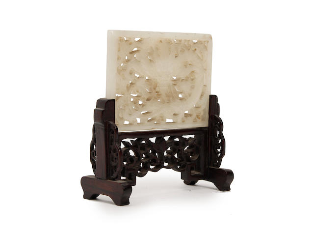 A pale green jade pierced belt plaque  Qing Dynasty
