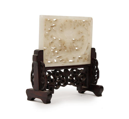 A pale green jade pierced belt plaque  Qing Dynasty