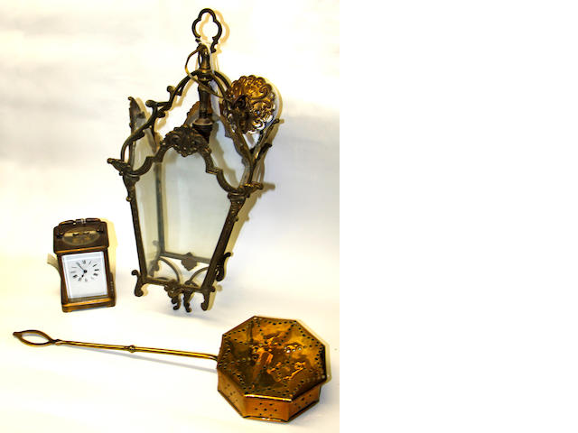 A French brass carriage timepiece, 14cm higha brass chestnut roaster; and a brass hanging lantern, 49cm high (3)
