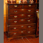 A late 18th Century provincial mahogany tallboythe upper aprt with two short and three long drawers, the lower part with two long drawers, all with original brass handles, on later bracket feet, 101cm wide