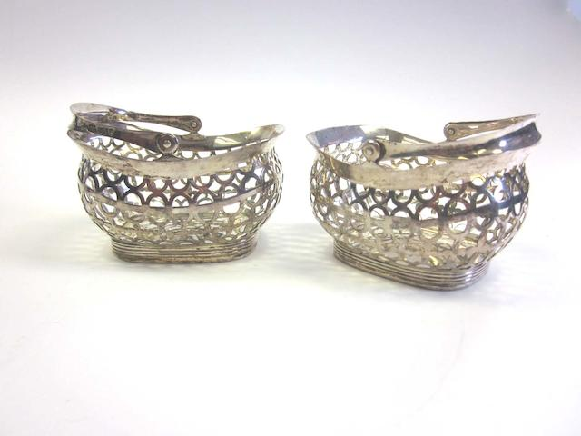 A pair of Victorian silver pierced swing-handled baskets by Thomas William Dobson, London 1896; together with a quantity of other items  (8)