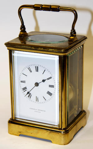 A French brass cased carriage clock, the enamel dial signed Jenner & Knewstub, London  with key