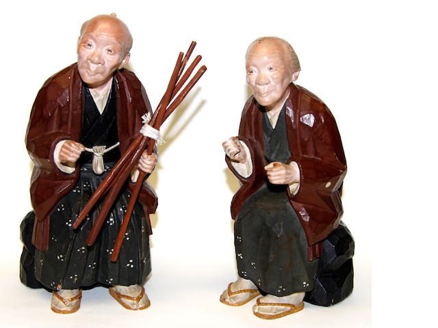 A pair of Japanese carved wooden figures Late 19th century