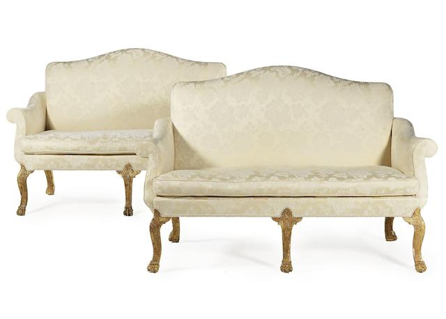A pair of carved giltwood and cut gesso sofas in the George I style