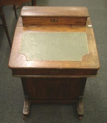 A Victorian walnut boxwood strung and foliate inlaid Davenport, with raised stationery compartment back, inset hinged sloping fall, four right hand drawers, on plinth base, 53cm.