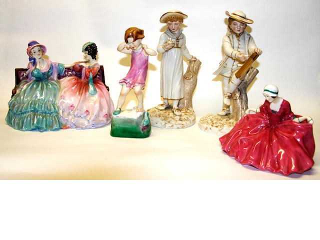 A pair of Royal Worcester figurines, together with another, and two Royal Doulton figures