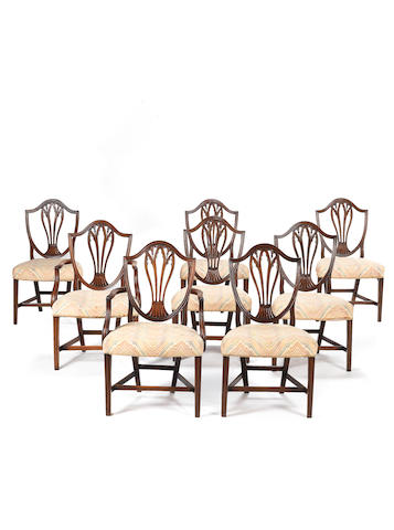 A set of eight George III carved mahogany dining chairs including a pair of open armchairspossibly by Gillows, in the Chippendale Gothick taste